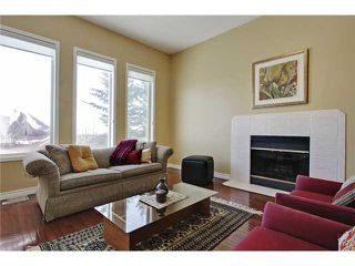 Photo 5: 68 STRADDOCK Crescent SW in Calgary: Strathcona Park House for sale : MLS®# C3653341