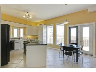 Photo 7: 68 STRADDOCK Crescent SW in Calgary: Strathcona Park House for sale : MLS®# C3653341