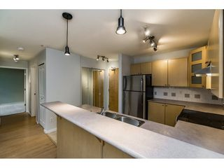 "Photo 3: 103 3136 ST JOHNS Street in Port Moody: Port Moody Centre Condo for sale in ""SONRISA"" : MLS®# R2105055"