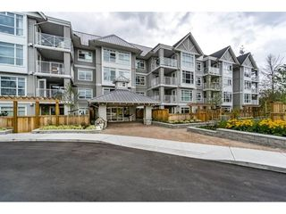 "Photo 2: 103 3136 ST JOHNS Street in Port Moody: Port Moody Centre Condo for sale in ""SONRISA"" : MLS®# R2105055"