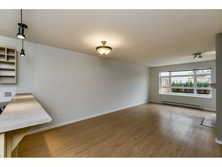 "Photo 5: 103 3136 ST JOHNS Street in Port Moody: Port Moody Centre Condo for sale in ""SONRISA"" : MLS®# R2105055"