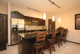 Photo 2: 411 103 VALLEY RIDGE Manor NW in Calgary: Valley Ridge Condo for sale : MLS®# C4108902