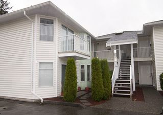"Photo 1: 221 7156 121 Street in Surrey: West Newton Townhouse for sale in ""Glenwood Village"" : MLS®# R2215838"