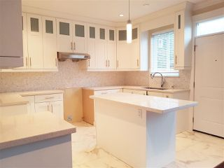Photo 6: 4866 MOSS Street in Vancouver: Collingwood VE House for sale (Vancouver East)  : MLS®# R2227855