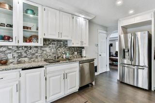 Photo 12: 103 COACH LIGHT Bay SW in Calgary: Coach Hill Detached for sale : MLS®# A1026742