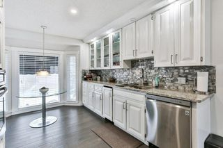 Photo 13: 103 COACH LIGHT Bay SW in Calgary: Coach Hill Detached for sale : MLS®# A1026742