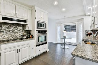 Photo 10: 103 COACH LIGHT Bay SW in Calgary: Coach Hill Detached for sale : MLS®# A1026742