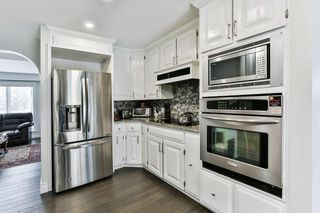 Photo 11: 103 COACH LIGHT Bay SW in Calgary: Coach Hill Detached for sale : MLS®# A1026742
