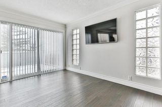Photo 7: 103 COACH LIGHT Bay SW in Calgary: Coach Hill Detached for sale : MLS®# A1026742
