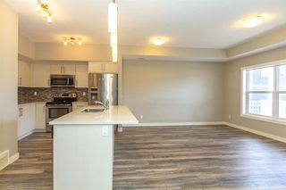 Photo 5: 1101 1225 KINGS HEIGHTS Way SE: Airdrie Row/Townhouse for sale : MLS®# A1031838