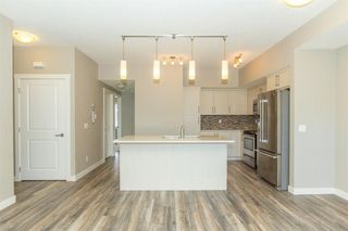 Photo 4: 1101 1225 KINGS HEIGHTS Way SE: Airdrie Row/Townhouse for sale : MLS®# A1031838