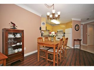 "Photo 11: 306 8115 121A Street in Surrey: Queen Mary Park Surrey Condo for sale in ""The Crossing"" : MLS®# F1404675"