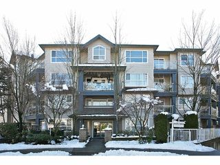 "Photo 1: 306 8115 121A Street in Surrey: Queen Mary Park Surrey Condo for sale in ""The Crossing"" : MLS®# F1404675"