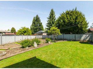 Photo 18: 9304 151ST Street in Surrey: Fleetwood Tynehead House for sale : MLS®# F1411768