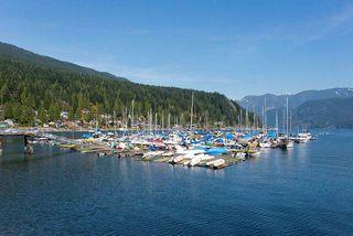 """Photo 1: 103 4390 GALLANT Avenue in North Vancouver: Deep Cove Condo for sale in """"DEEP COVE ESTATES"""" : MLS®# R2150976"""
