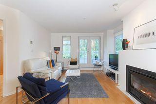 """Photo 2: 103 4390 GALLANT Avenue in North Vancouver: Deep Cove Condo for sale in """"DEEP COVE ESTATES"""" : MLS®# R2150976"""