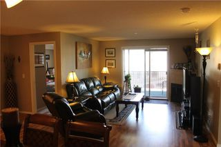 Photo 8: 7307 304 MACKENZIE Way SW: Airdrie Condo for sale : MLS®# C4124010