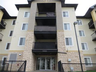 Photo 1: 7307 304 MACKENZIE Way SW: Airdrie Condo for sale : MLS®# C4124010