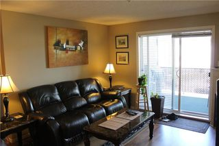 Photo 7: 7307 304 MACKENZIE Way SW: Airdrie Condo for sale : MLS®# C4124010