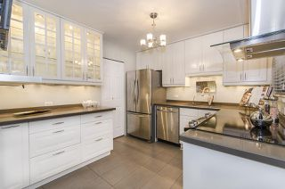 """Photo 1: 1237 PLATEAU Drive in North Vancouver: Pemberton Heights Condo for sale in """"Plateau Village"""" : MLS®# R2224037"""