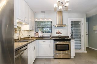 """Photo 2: 1237 PLATEAU Drive in North Vancouver: Pemberton Heights Condo for sale in """"Plateau Village"""" : MLS®# R2224037"""