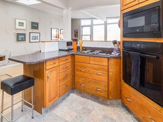 Photo 12: 2611 CANMORE RD NW in Calgary: Banff Trail House for sale : MLS®# C4146643