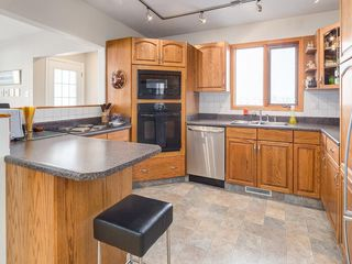 Photo 9: 2611 CANMORE RD NW in Calgary: Banff Trail House for sale : MLS®# C4146643