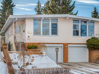 Photo 1: 2611 CANMORE RD NW in Calgary: Banff Trail House for sale : MLS®# C4146643