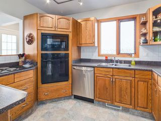 Photo 10: 2611 CANMORE RD NW in Calgary: Banff Trail House for sale : MLS®# C4146643