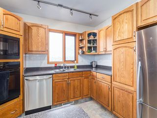 Photo 11: 2611 CANMORE RD NW in Calgary: Banff Trail House for sale : MLS®# C4146643