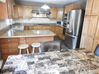 Photo 6: 611 ROMANIUK Road in Edmonton: Zone 14 House for sale : MLS®# E4176330