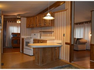 "Photo 4: 110 8224 134 Street in Surrey: Queen Mary Park Surrey Manufactured Home for sale in ""Westwood Gate"" : MLS®# F1322343"