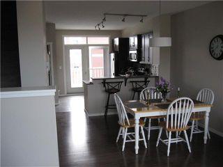 Photo 3: 50 EVANSVIEW Road NW in CALGARY: Evanston Townhouse for sale (Calgary)  : MLS®# C3610458