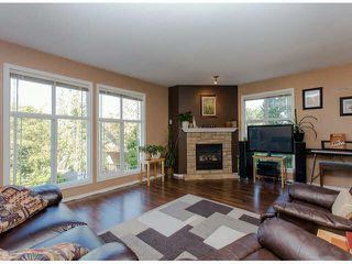 """Photo 2: 28 46906 RUSSELL Road in Sardis: Promontory Townhouse for sale in """"RUSSELL HEIGHTS"""" : MLS®# H2150113"""