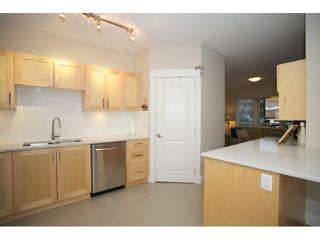 "Photo 9: 108 5811 177B Street in Surrey: Cloverdale BC Condo for sale in ""LATIS"" (Cloverdale)  : MLS®# R2023487"