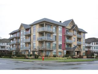 "Photo 1: 108 5811 177B Street in Surrey: Cloverdale BC Condo for sale in ""LATIS"" (Cloverdale)  : MLS®# R2023487"