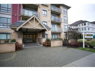 "Photo 2: 108 5811 177B Street in Surrey: Cloverdale BC Condo for sale in ""LATIS"" (Cloverdale)  : MLS®# R2023487"
