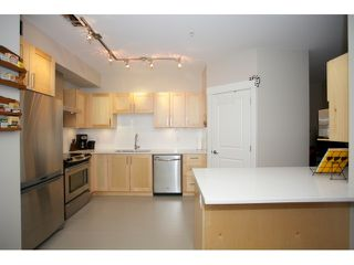 "Photo 8: 108 5811 177B Street in Surrey: Cloverdale BC Condo for sale in ""LATIS"" (Cloverdale)  : MLS®# R2023487"