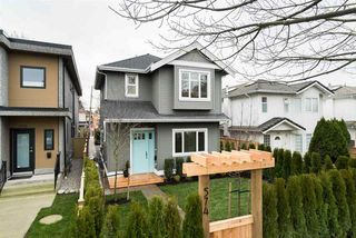 Photo 1: 574 E 16TH Avenue in Vancouver: Fraser VE House 1/2 Duplex for sale (Vancouver East)  : MLS®# R2039860