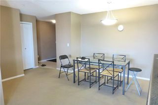 Photo 4: 2101 8 BRIDLECREST Drive SW in Calgary: Bridlewood Condo for sale : MLS®# C4113110