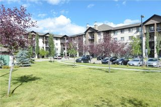Photo 2: 2101 8 BRIDLECREST Drive SW in Calgary: Bridlewood Condo for sale : MLS®# C4113110