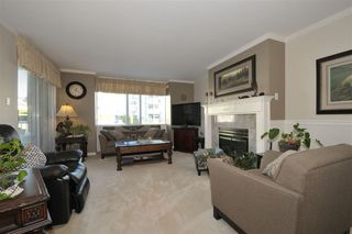 """Photo 1: 203 9763 140 Street in Surrey: Whalley Condo for sale in """"Fraser Gate"""" (North Surrey)  : MLS®# R2214649"""