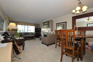 """Photo 2: 203 9763 140 Street in Surrey: Whalley Condo for sale in """"Fraser Gate"""" (North Surrey)  : MLS®# R2214649"""