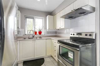 Photo 2: 102 4893 CLARENDON STREET in Vancouver: Collingwood VE Condo for sale (Vancouver East)  : MLS®# R2211401