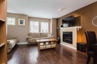 "Photo 2: 89 12711 64 Avenue in Surrey: West Newton Townhouse for sale in ""Pallette On The Park"" : MLS®# R2216923"