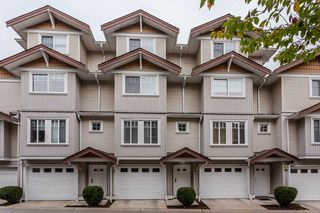 "Photo 1: 89 12711 64 Avenue in Surrey: West Newton Townhouse for sale in ""Pallette On The Park"" : MLS®# R2216923"