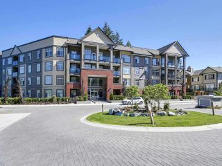 "Photo 1: 106 2855 156 Street in Surrey: Grandview Surrey Condo for sale in ""CONDO AT THE HEIGHTS"" (South Surrey White Rock)  : MLS®# R2230927"