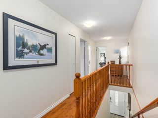 """Photo 12: 1209 GALIANO Street in Coquitlam: New Horizons House for sale in """"New Horizons"""" : MLS®# R2323174"""