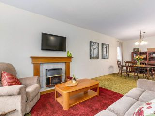 """Photo 7: 1209 GALIANO Street in Coquitlam: New Horizons House for sale in """"New Horizons"""" : MLS®# R2323174"""