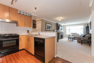 Photo 10: 204 300 KLAHANIE Drive in Port Moody: Port Moody Centre Condo for sale : MLS®# R2340249